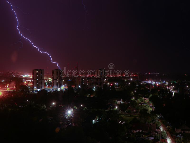 Lightning hits the night city building royalty free stock photography