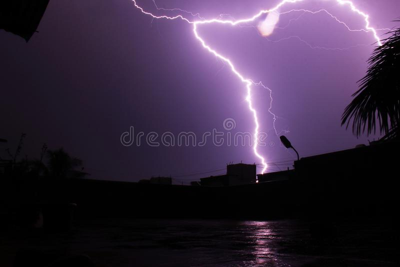Lightning hitting building top at Pune, India.  royalty free stock photography