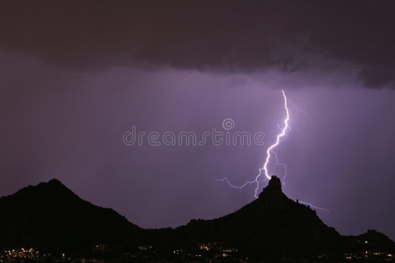Lightning hitting pinnacle peak stock photography