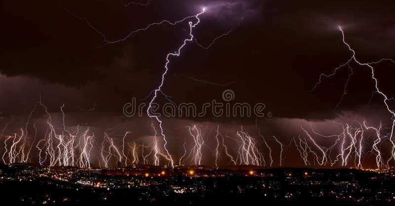 Lightning over city stock photography