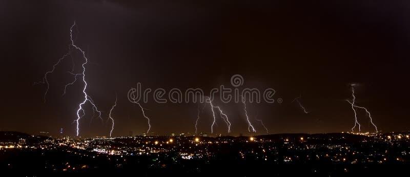 Lightning over city stock photo