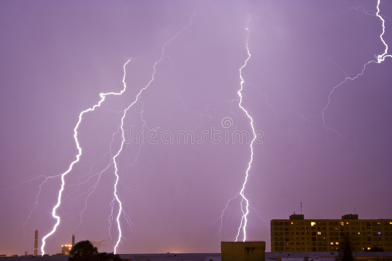 Lightning over city skyline royalty free stock photo