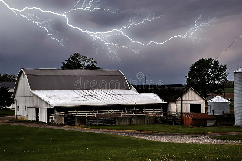 Lightning over Farm. Lightning captured over a dairy barn and shed stock images