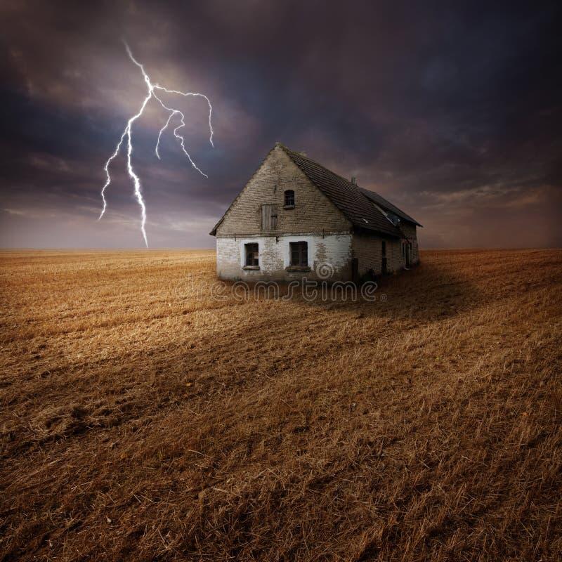 Lightning over farm in field