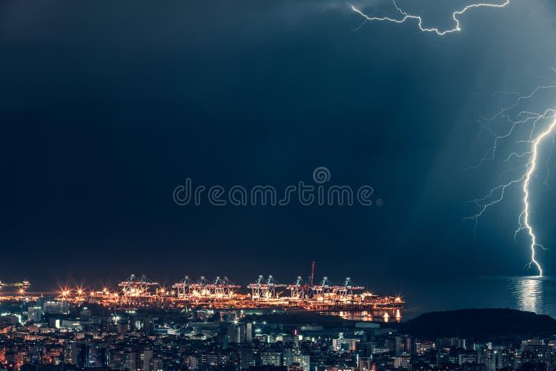 Lightning over night city royalty free stock photo