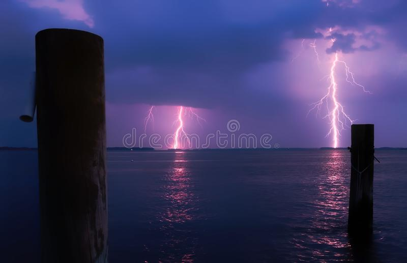 Lightning over Sea Against Storm Clouds royalty free stock photos