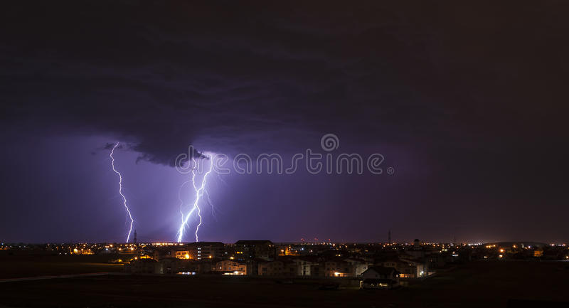 Download Lightning over small town stock photo. Image of storm - 31443306