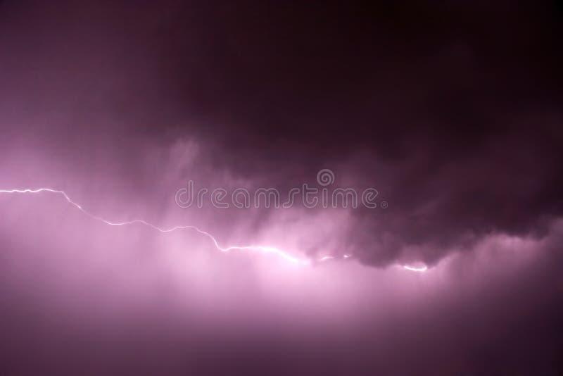 Lightning with purple tint stock photo