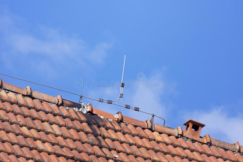 Lightning rod wire on the roof stock images