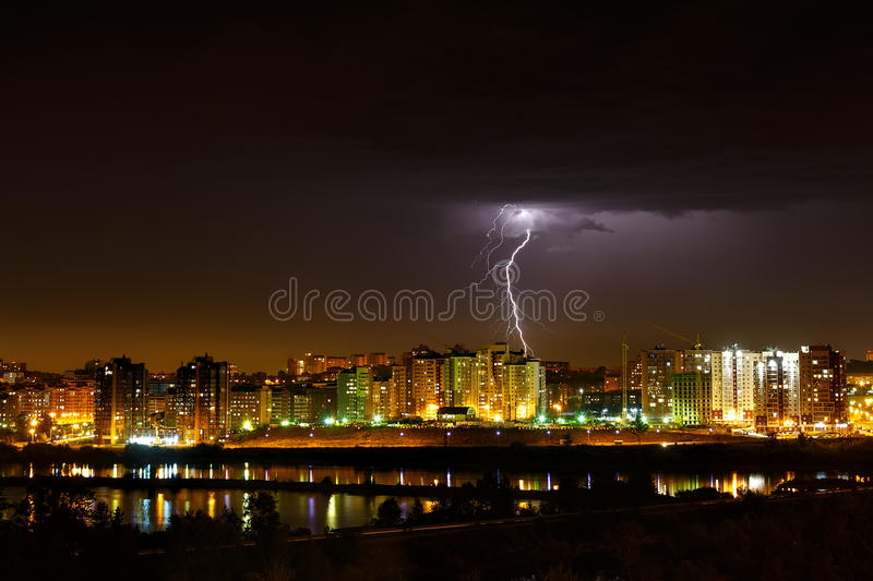 Lightning in the sky with cityscape stock image