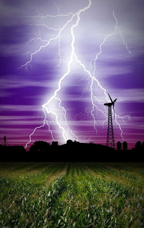 Lightning Storm. Over a farm in Iowa, cornfield windmill,and farm stock photos