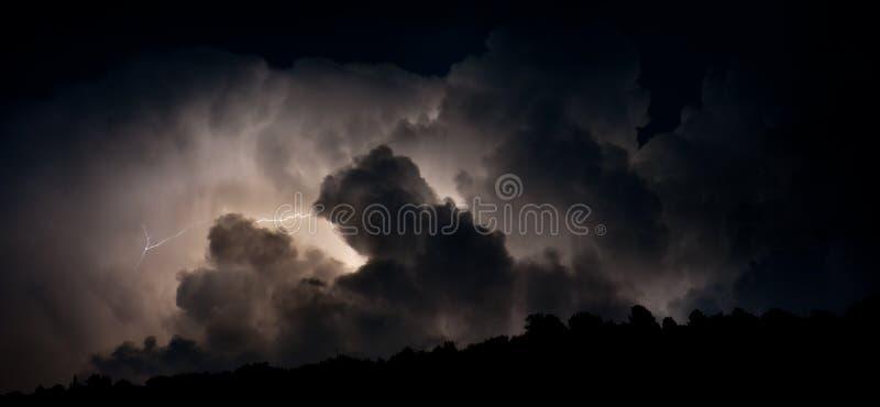 Lightning. Storm lightning on dark cloudy sky stock photo