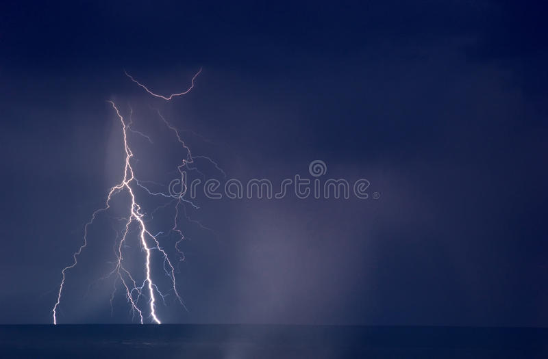 Lightning Storm. Over big lake Balkhash, Kazakhstan NOTE: Noise and low resolution because a night shot with long exposition royalty free stock images