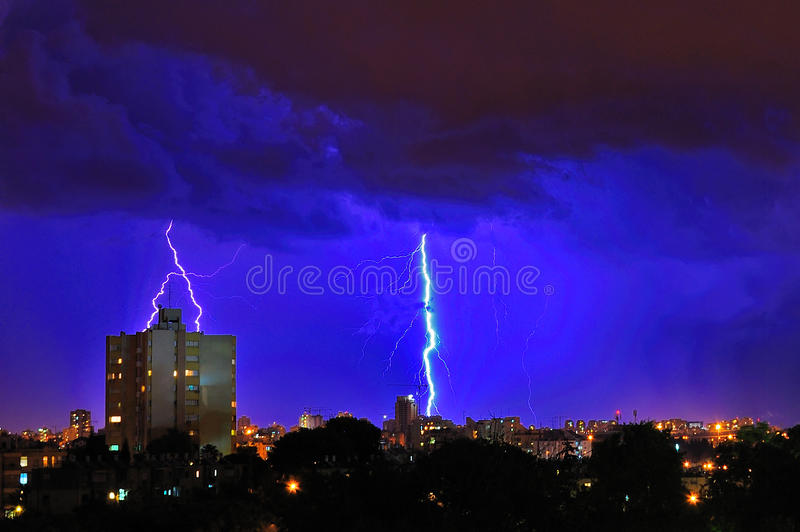 Lightning Storm over city. A city view during a lightning storm royalty free stock image