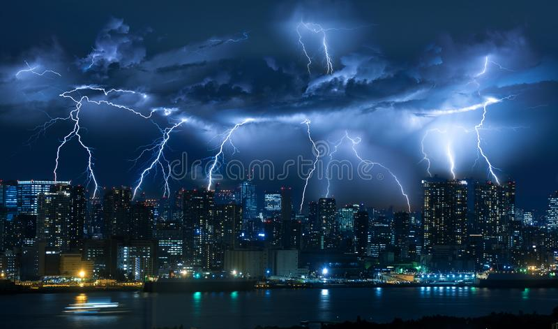 Lightning storm over city in blue light royalty free stock photos