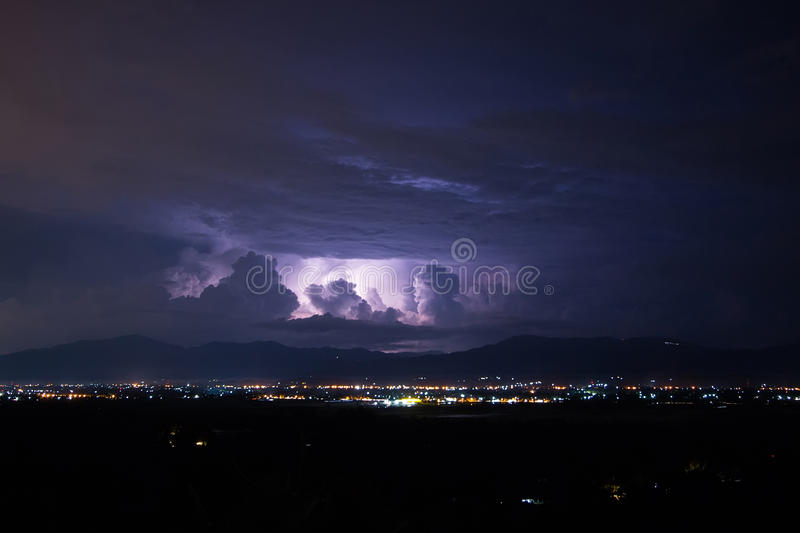 Lightning storm over city. Chiang mai, Thailand stock images