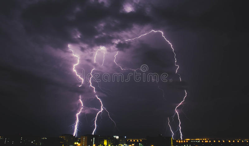 Lightning storm over countryside city at night in Thailand. Lightning storm over countryside city, at night in Thailand royalty free stock photos