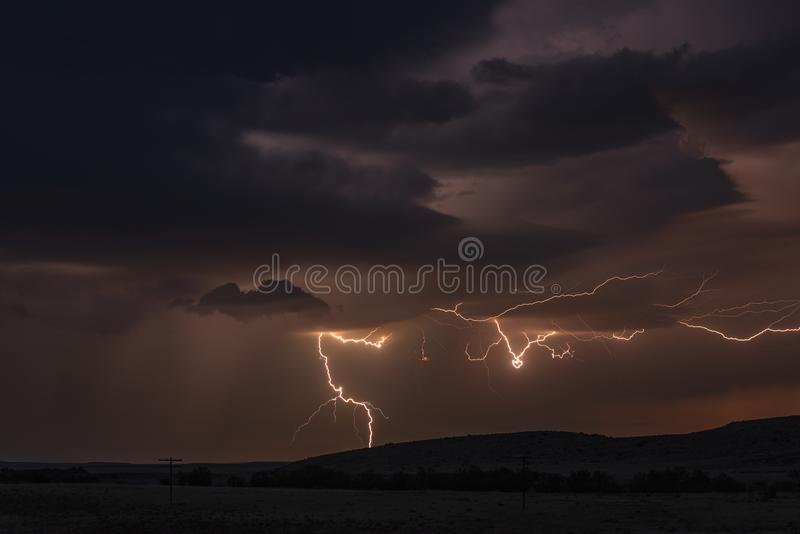 Lightning storm over field in Roswell New Mexico stock images