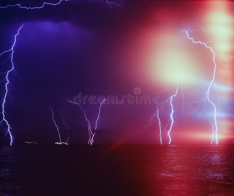 Lightning storm in the sea royalty free stock photography