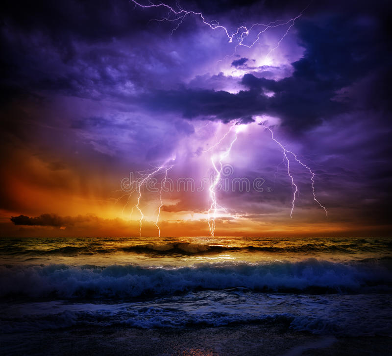 Lightning and storm on sea to the sunset. Bad weather stock photography