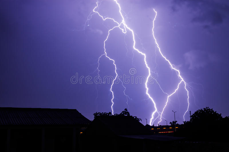Lightning Storm in The Sky of Night. Silhouette of a landscape when lightning storm flashed in the sky of night. Long exposure photography royalty free stock photos