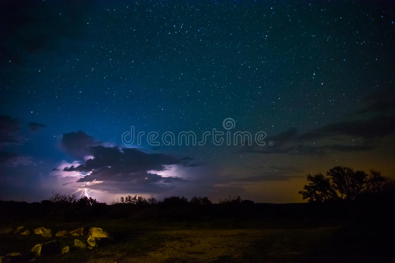 Lightning Storm with Stars. Lightning storm off in the distance with stars in the night sky royalty free stock images