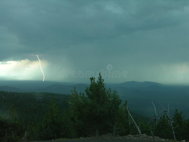 Lightning Strike. A bolt of lightning strikes the ground during a thunderstorm in Oregon's high desert stock photos