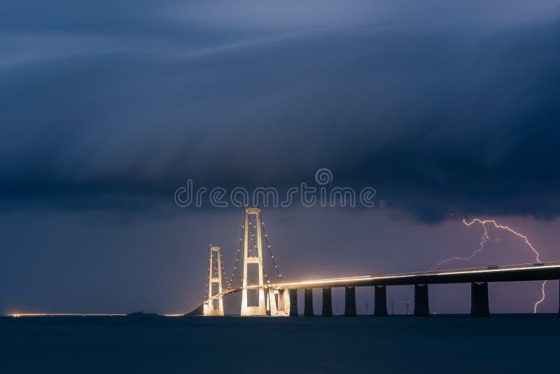 Lightning strike behind the Great Belt bridge royalty free stock photo
