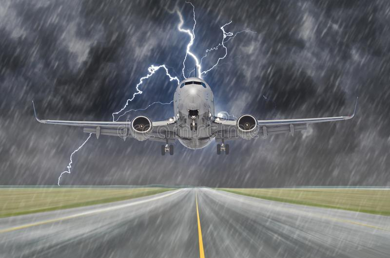 Lightning strike bolt during a thunderstorm and heavy rain in the aircraft airport during landing. Lightning strike bolt during a thunderstorm and heavy rain in royalty free stock photos