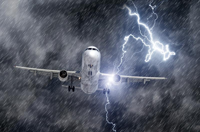 Lightning strike bolt during a thunderstorm and heavy rain in the aircraft engine during landing. Lightning strike bolt during a thunderstorm and heavy rain in stock images