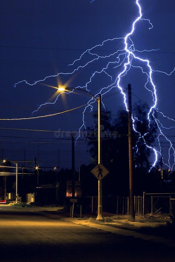 lightning strike in the city of tucson arizona at nighttime stock