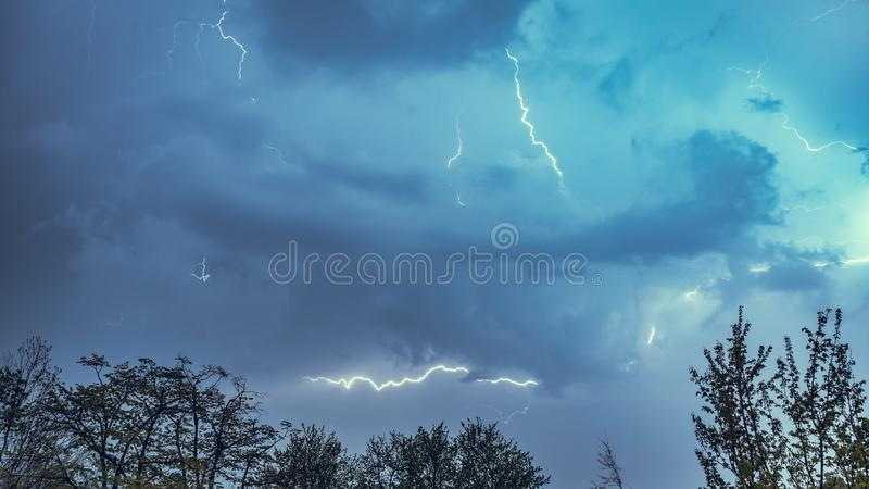 Lightning strike on a cloudy dramatic stormy sky royalty free stock photo