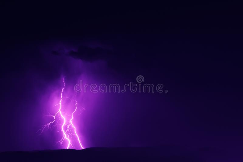 Lightning strike in the night sky royalty free stock photos