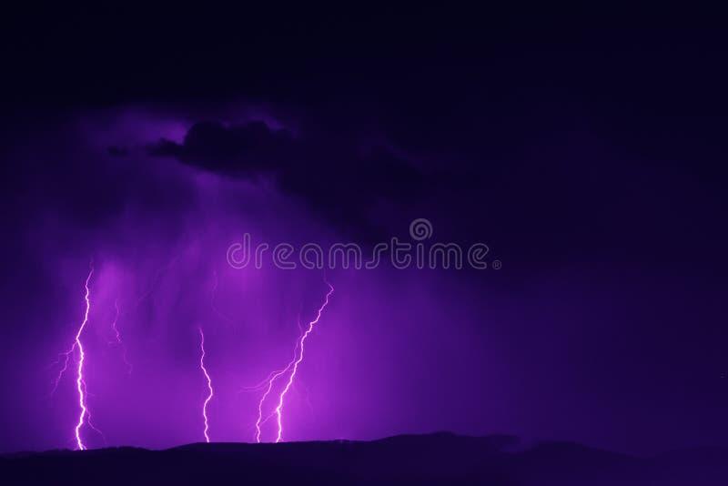 Lightning strike in the night sky stock photo