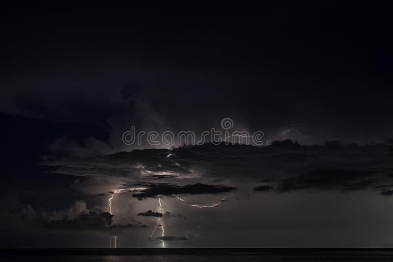 Lightning strike over the sea stock images