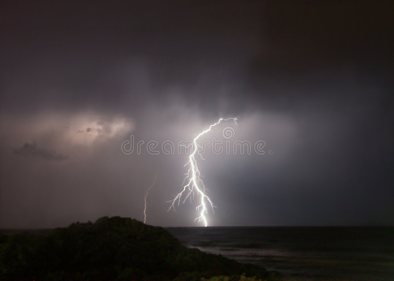 Lightning strike at sea stock images