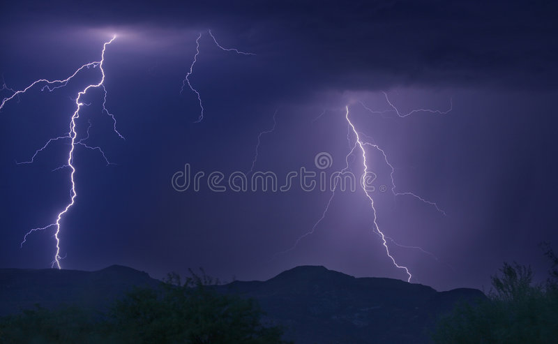 Lightning Strikes. Multiple lightning strikes in mountains of the Arizona desert royalty free stock photos