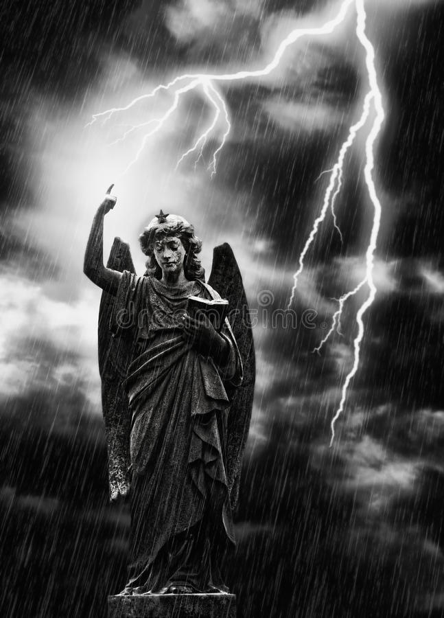 Lightning Strikes the Angel Gabriel. Religious concept image, lightning striking a statue of the angel Gabriel stock photography