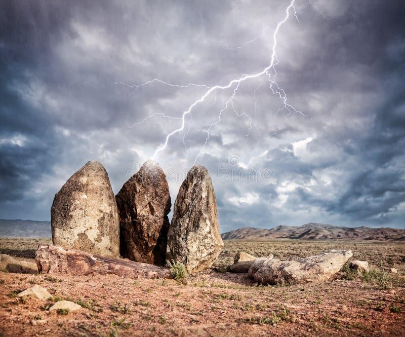 Lightning strikes big stones royalty free stock photography