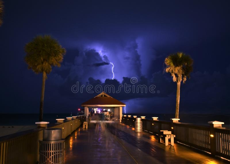 A lightning strikes captured from Clearwater beach pie. R using a long exposure depicting enigma, mystery and that there is light even in darkness royalty free stock photography
