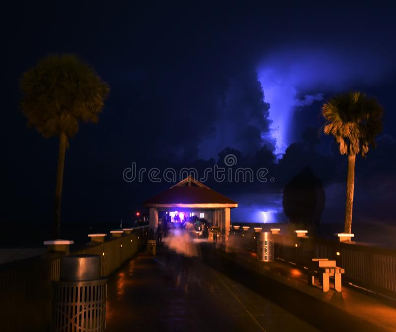 A lightning strikes captured from Clearwater beach pie. R using a long exposure depicting enigma, mystery and that there is light even in darkness stock photography
