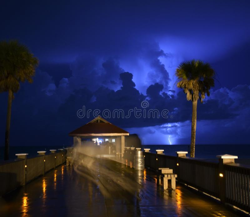 A lightning strikes captured from Clearwater beach pie. R using a long exposure depicting enigma, mystery and that there is light even in darkness stock photo