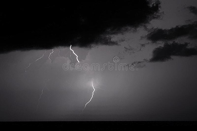 Lightning strikes dominate the sky over the Atlantic ocean during the summer months. Summertime storms are dramatic displays of nature with thunder and lightning royalty free stock photo