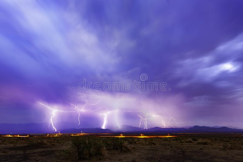 Multiple lightning Strikes in dark blue sky. Multiple lightning strikes on a distant horizon with dark blue sky royalty free stock images