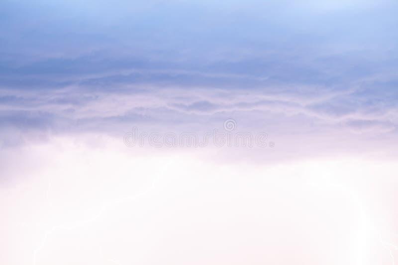 Lightning strikes storm over city purple light. royalty free stock images