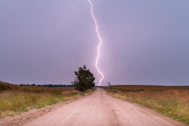Lightning Striking the Road. Lightning strikes the town of Heartwell in south central Nebraska royalty free stock photo