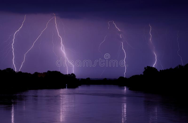 Lightning at Summer Night. Summer Thunderbolt Night Storm over River at Night stock photos