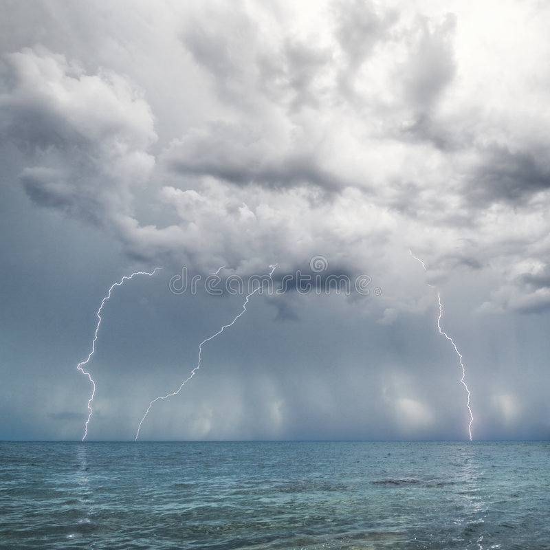 Lightning and thunderstorm above sea stock photos
