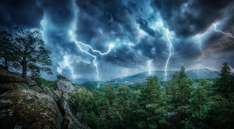Lightning thunderstorm flash in the mountains. Concept on topic stock image