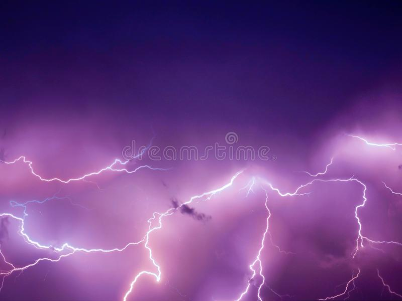 Lightning thunderstorm flash over the night sky. Concept on topic weather stock photography